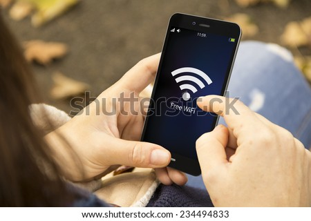 connectivity concept: Free wifi area sign on phone screen - stock photo