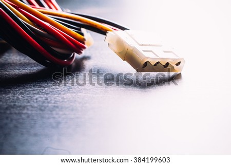 connector plug  of  computer power supply on dark background - stock photo