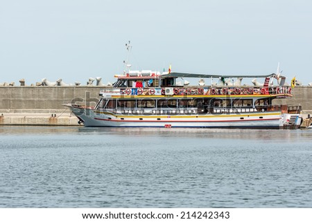 CONSTANTA, ROMANIA - AUGUST 01, 2014: People Boat Trip In Port Tomis Of Constanta At The Black Sea. - stock photo