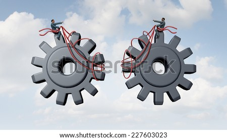 Constructing a business as a team of  people joining together for success as two businessmen partners guiding gears and cog wheels using a harness as a metaphor for cooperation and partnership. - stock photo