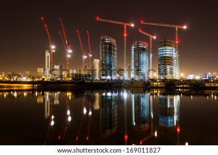 Construction and cranes - stock photo