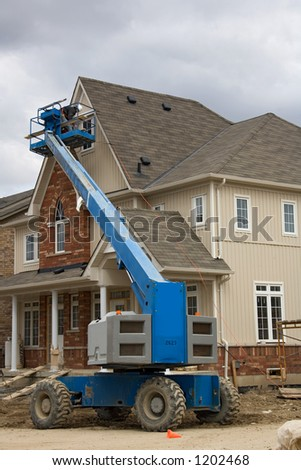 construction boom lift. - stock photo