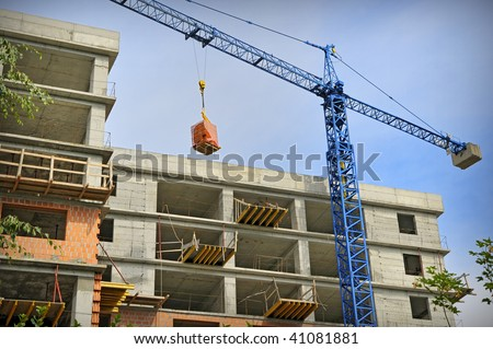 Construction building with crane - stock photo