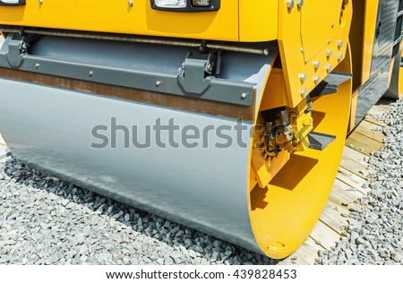Construction compactor in the operation. Construction compactor photographed close up. focus in the center of the frame in the Construction compactor - stock photo