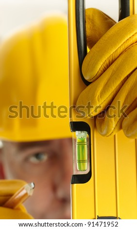 construction concept, selective focus on foreground (nearest part of tool), shallow depth of field - stock photo