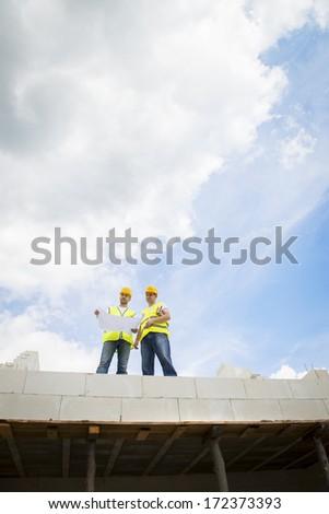 Construction Contractors building a big new home - stock photo