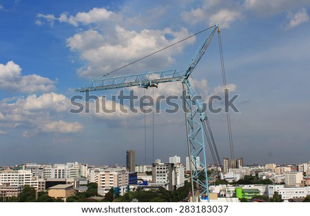 construction crane and the city - stock photo