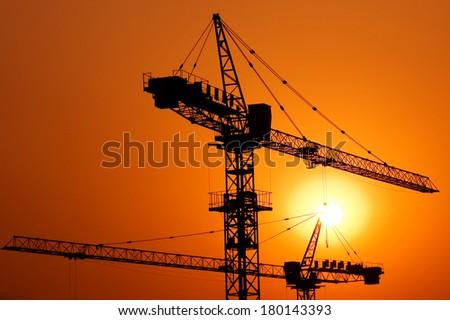 Construction Crane at Sunset - stock photo