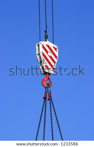 Construction crane hook and pulley - stock photo