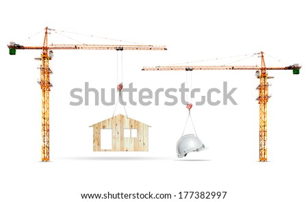 construction crane lifting home and safety helmet on white background use for construction industry and residence real estate land development - stock photo