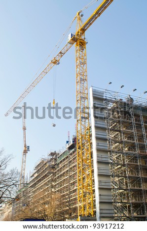 Construction crane on the site - stock photo