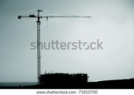 construction crane silhouette - stock photo
