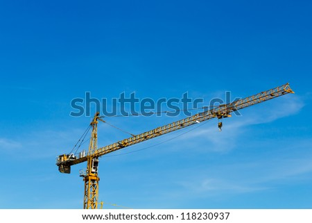 Construction crane with the cleared blue sky. - stock photo