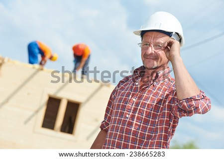 construction engeneer worker project manager at building site - stock photo