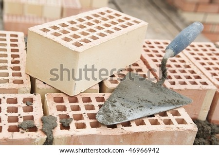 Construction equipment for brick building work trowel - stock photo