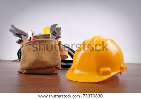 Construction equipments on wood background with copy space - a series of CONSTRUCTION IMAGES. - stock photo