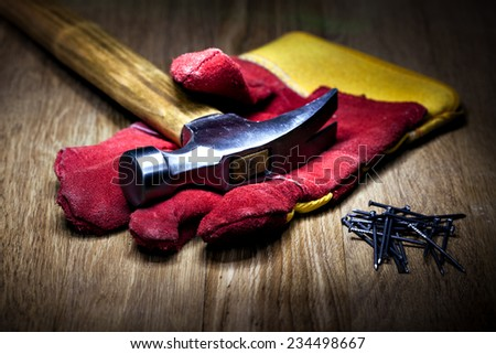 Construction gloves and hammer on a white background - stock photo