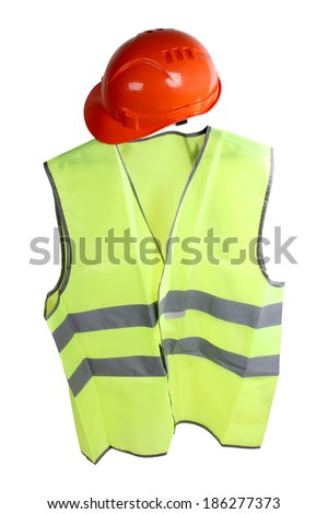 Construction hard hat and high visibility vest on a white background - stock photo