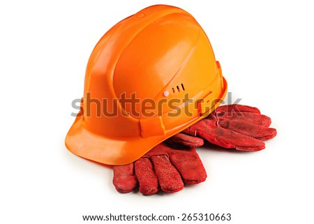 construction helmet and gloves on white background - stock photo