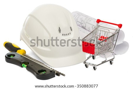 Construction helmet, builders level and shopping cart on isolated white background - stock photo