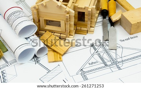 Construction house. Repair work. Joiner's works. Drawings for building, working tools and small wooden house. - stock photo