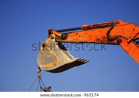 construction machinery closeup - backhoe - stock photo