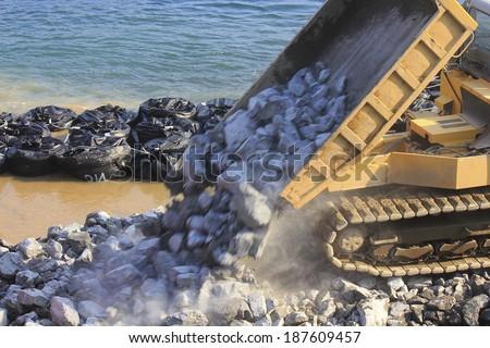 Construction machinery for coastal construction - stock photo