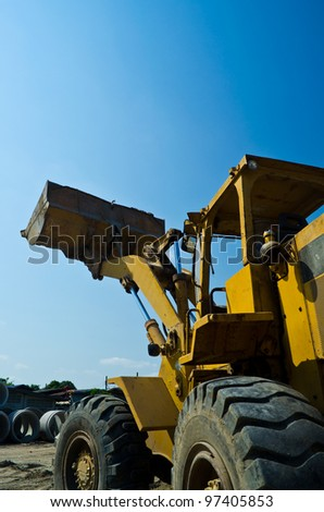 construction machinery  on blue sky - stock photo