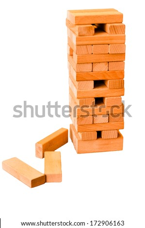 Construction made by Jenga bricks - isolated - stock photo