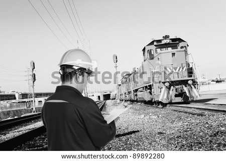 construction man works at train station - stock photo