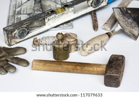 Construction masonry cement mortar tools on white - stock photo