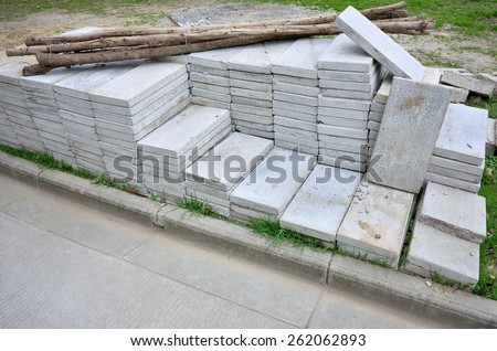 Construction material -- Paving stone and timber - stock photo