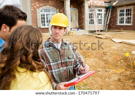 Construction: New Home Construction Site with Builder. - stock photo