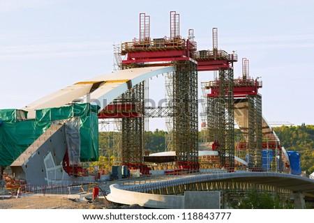 Construction of a bridge over the river - stock photo