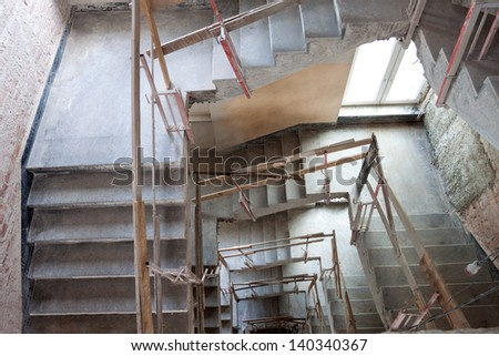 Construction of a lift shaft with staircase, bird eye view. - stock photo