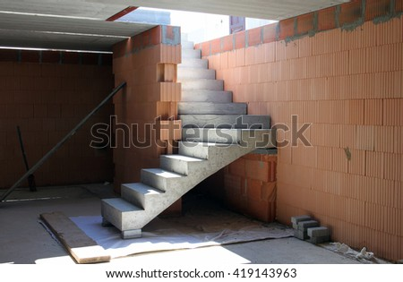 Construction of a new building, concrete stairs - stock photo