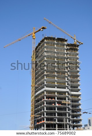 Construction of a new building on the skyline - stock photo