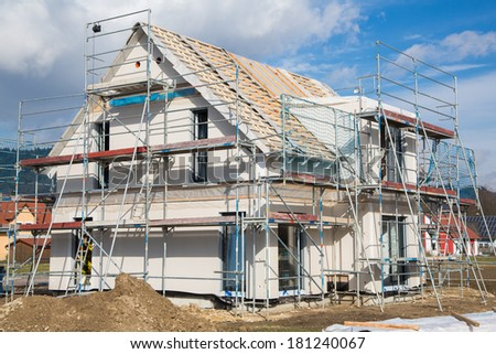 Construction of a new prefabricated house of stone and wood. - stock photo
