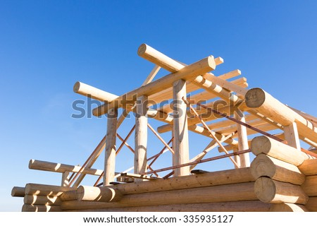 Construction of a wooden house in nature - stock photo