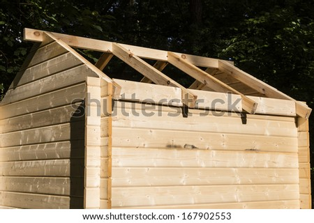 Construction of a wooden hut - stock photo