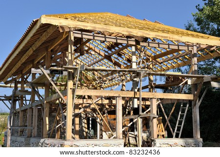 construction of an eco-cottage in wood - stock photo