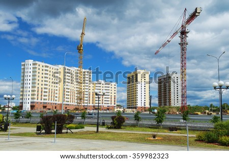 Construction of apartment houses in Sunny summer day - stock photo
