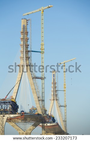 Construction of big guyed bridge in C���¡diz over the sea - stock photo