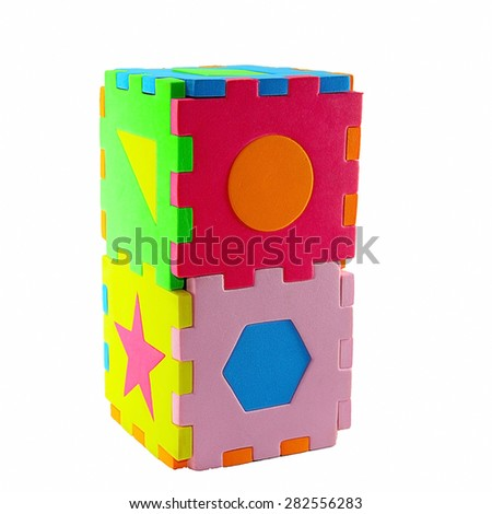 Construction of box from children's puzzle. Isolated on white - stock photo
