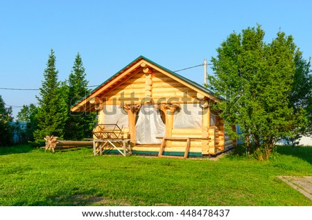 Construction of country timber houses of wood with the roots - feet. - stock photo