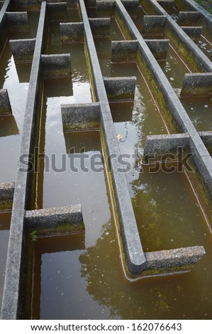 construction of drainage water filtration,built by the Dutch during the occupation in the city of Tarakan, Indonesia - stock photo