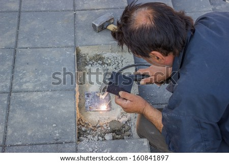 construction of metal hand railing of new stairs, welding steel - stock photo