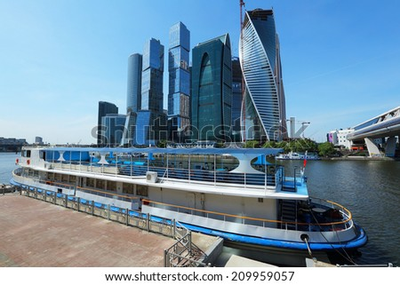 Construction of modern skyscrapers business center at the Moscow River embankment, Russia. - stock photo