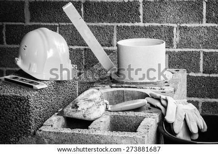 Construction of modular ceramic chimney in the house. B/W - stock photo