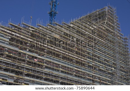 Construction of new building with one crane in background - stock photo